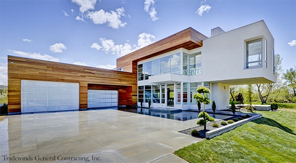 Luxury House with Two White Glass Garage Doors