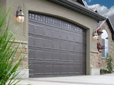 Dark brown modern garage door with small windows at the top